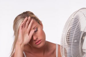 woman-with-fan-overheated